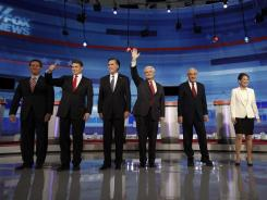 Republican presidential candidates from left, Rick Santorum, Rick Perry, Mitt Romney, Newt Gingrich, Ron Paul, Michele Bachmann and Jon Huntsman arrive for a debate in Sioux City, Iowa.