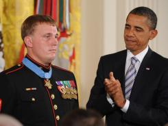 President Obama presents the Medal of Honor to U.S. Marine Cpl. Dakota Meyer at the White House Sept. 15.