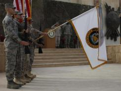 The U.S. Forces Iraq colors are lowered before being encased during a ceremony in Baghdad on Thursday as the U.S. officially ended involvement in the war.