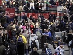 Travelers wait in long lines at check-in and security at Minneapolis-St. Paul International Airport in December 2010.