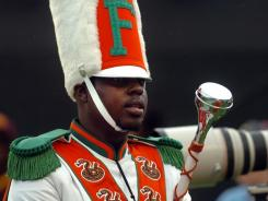 Robert Champion performs during halftime of Florida A&M's football game against Bethune-Cookman in Orlando on Nov. 19. After the game, Champion was vomiting before becoming unresponsive aboard a band bus.