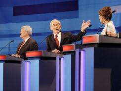 Former House speaker Newt Gingrich, Rep. Ron Paul and Rep. Michele Bachmann participate in Thursday night's GOP presidential debate in Sioux City, Iowa.
