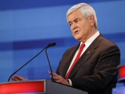 Former House speaker Newt Gingrich speaks during Thursday's GOP debate in Sioux City, Iowa.