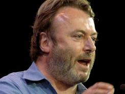 Essayist Christopher Hitchens speaks during a debate on Iraq and the foreign policies of the United States and Britain, in this Sept. 14, 2005 file photo taken in New York.