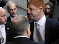 Penn State assistant football coach Mike McQueary, right, arrives at Dauphin County Court Friday in Harrisburg, Pa. Charges against former Penn State University athletic director Tim Curley and former senior vice president Gary Schultz largely centered on McQueary's testimony.