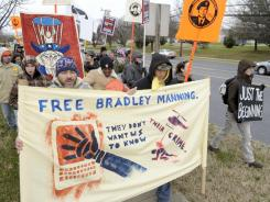 Protestors supporting Pfc. Bradley Manning march outside the gate of Ft. Meade, Md., on Friday, where Manning attended a hearing to determine if he will be court martialed.