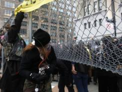 Occupy Wall Street activists enter the private park owned by Trinity Church, next to Duarte Square, on Saturday in New York City.