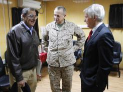 U.S. to ensure Afghans are ready to take over:  Defense Secretary Leon Panetta, left, talks with U.S. Ambassador to Afghanistan Ryan Crocker, right, and Marine Gen. John Allen in Kabul on Dec. 13.