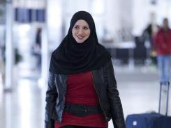 """Suehaila Amen prepares to depart Detroit in a scene from the reality TV show """"All-American Muslim."""""""