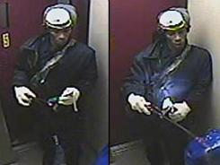 This Saturday, Dec. 17, 2011, surveillance photo provided by the New York Police Department shows a suspect wanted in connection with the burning death of a woman in a Brooklyn elevator.