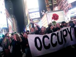 Occupy Wall Street activists demonstrate Saturday in New York City's Times Square.