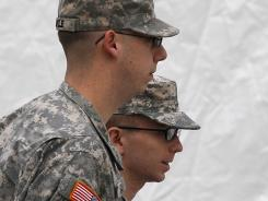 Army Pfc. Bradley Manning, right, is escorted into a courthouse Sunday in Fort Meade, Md.