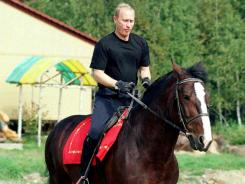 August 2001: Then-Russian President Vladimir Putin in Verkhniye Mondrogi.
