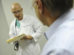 Christopher Mesick, an otolaryngologist, examines patient Wayne Kubicki in Washington, D.C.