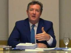 In this image made from video, CNN star interviewer Piers Morgan answers questions from a media ethics inquiry sitting in London.