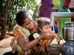 A mother and her child in Andhra Pradesh, India, enjoy clean drinking water from a well drilled by Living Water International.