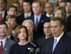 House Speaker John Boehner, R-Ohio, with colleagues, speaks at a news conference Tuesday on Capitol Hill.