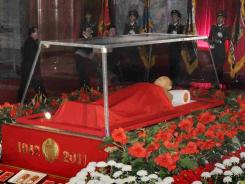 The body of North Korean leader Kim Jong Il is displayed in a memorial palace in Pyongyang, North Korea, on Tuesday