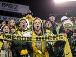 Oregon fans celebrate during the NCAA Pac-12 Championship college football game in Eugene, Ore., on Dec 2.