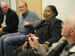 Theresa Jennings, center, and Jim Towler share a laugh as they decide how to use the offices of the Promise Neighborhood and Diversity Thru Colors in St. Cloud, Minn.