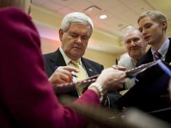 Former House Speaker Newt Gingrich signs autographs after a rally on Dec. 21 in Arlington, Va. Gingrich is campaigning to become the Republican presidential candidate to run against President Obama in the 2012 election.