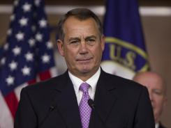 Speaker of the House John Boehner, R-Ohio, gestures during a news conference on the payroll tax cut on Capitol Hill on Thursday.