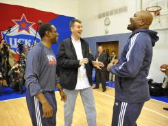 Mikhail Prokhorov, owner of the New Jersey Nets, talks with Avery Johnson, left, and Billy King during practice Oct. 10, 2010, in Moscow.