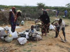 Somalis rest outside a makeshift shelter in a refugee camp in Mogadishu, Somalia, on Aug. 18. The worst drought in the Horn of Africa has sparked a severe food crisis and high malnutrition rates.