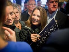 Rep. Michele Bachmann, R-Minn., talks with supporters at Hamburg Inn in Iowa City on Thursday.