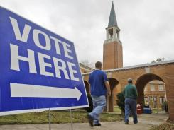 Two men walk to a polling place in Little Rock, Ark., to vote on Nov. 8.