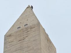 An engineer rigs rappelling gear on the Washington Monument on Nov. 10 in preparation for the National Park Service to make temporary weatherization measures.