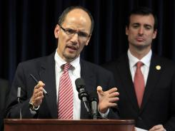 Thomas Perez, left, assistant attorney general for civil rights, announced the department's findings on South Carolina's voter-identification law.
