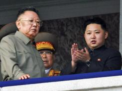 In this Oct. 10, 2010, file photo, Kim Jong Un, right, along with his father and North Korea leader Kim Jong Il, left, attends a military parade.
