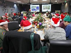 "Volunteers at Peterson Air Force Base in Colorado were fielding 8,000 calls an hour Saturday afternoon, on pace to break a record. Also, Santa's NORAD Facebook page approached 920,000 ""likes"" by midafternoon. Last year, Santa had 716,000 ""likes."""
