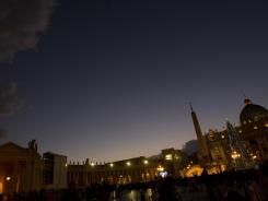 Faithful gather in St. Peter's Square at the Vatican after the unveiling of the nativity scene Saturday,