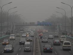 Cars travel on a ring road around Beijing on Dec. 5, a day the U.S. Embassy said had hazardous air-quality levels.