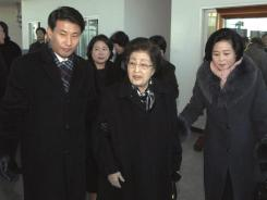 In this photo released by the Korean Central News Agency, Lee Hee-ho, the wife of former South Korean President Kim Dae-jung, center, and Hyundai Group Chairwoman Hyun Jeong-eun, behind Lee, arrive in Pyongyang on Monday,