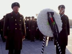 Korean People's Army soldiers pay respects to late North Korean leader Kim Jong Il early Monday in Kim Il Sung Square in Pyongyang.