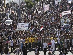 Protesters march during a demonstration demanding the prosecution of Yemen's President Ali Abdullah Saleh in Sanaa, on Sunday.