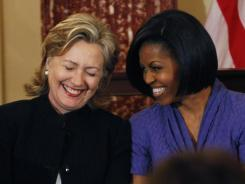 Secretary of State Hillary Clinton, left, is the most admired woman in 2011, according to a USA TODAY/Gallup Poll. First lady Michelle Obama came in third behind Oprah Winfrey.