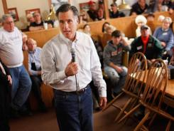 Former Massachusetts governor Mitt Romney campaigns on Wednesday in Clinton, Iowa.