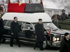 In this image made from KRT video, Kim Jong Un, center, Kim Jong Il's youngest son and successor, walks next to his father's hearse during a funeral procession.