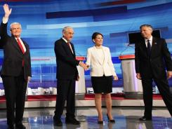 Former House speaker Newt Gingrich, Texas Rep. Ron Paul, Minnesota Rep. Michele Bachmann and former Utah governor Jon Huntsman participate in a GOP presdential debate on Dec. 15 in Sioux City, Iowa.