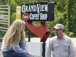 In this photo on June 3, 2009, Donald Crabtree, owner of the Grand View Topless Coffee Shop, right, speaks with Krista MacIntyre, left, a waitress at the shop.