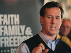 Republican presidential candidate Rick Santorum speaks at The Button Factory restaurant during a campaign stop Thursday in Muscatine, Iowa.