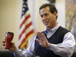 Former Pennsylvania senator Rick Santorum speaks during a campaign stop in Coralville, Iowa, on Dec. 29.