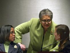 Atlanta Public Schools Superintendent Beverly Hall, center, speaks with school board member LaChandra Butler Parks, left, and Cecily Harsch-Kinnane, vice chairwoman of the board, right, during a school board meeting in Atlanta on Jan. 18.