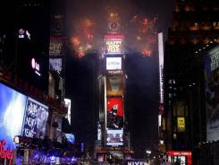 This Jan. 1, 2011, file photo shows fireworks as they erupt from a building  in New York's Times Square.