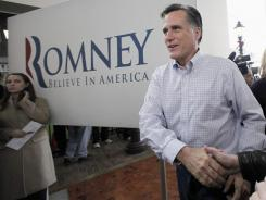 Mitt Romney arrives at a campaign stop Thursday in Mason City, Iowa
