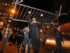 Occupy Wall Street protesters carry a barricade they removed from Zuccotti Park in New York on Saturday.